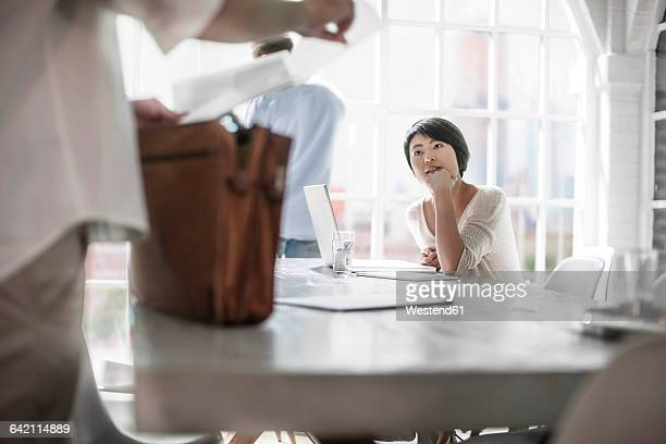 Woman working in city office, colleague, listening