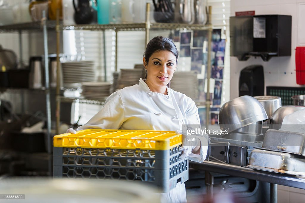 Woman working in commercial kitchen : Stock Photo