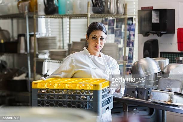 Woman working in commercial kitchen