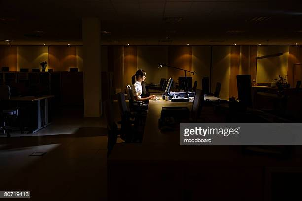 woman working in dark office - overworked stock pictures, royalty-free photos & images