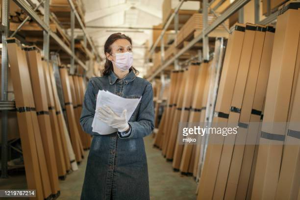 woman working in distribution warehouse - miljko stock pictures, royalty-free photos & images