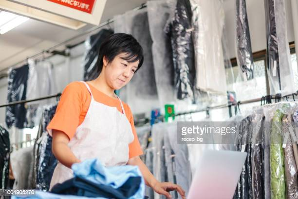Woman working in dry cleaning shop