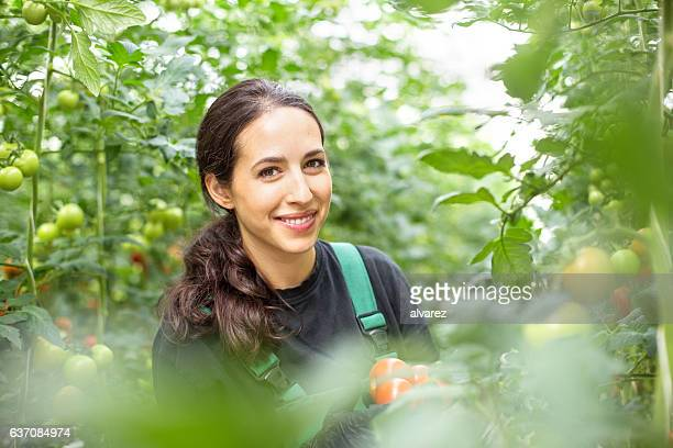 Woman working in green house