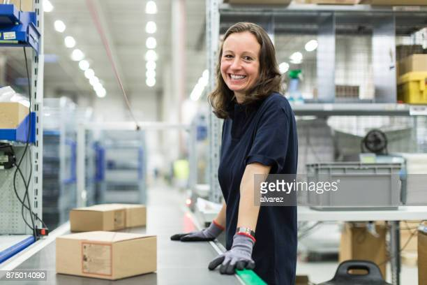 Woman working in large distribution warehouse