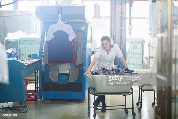 woman working in laundry - sigrid gombert stock pictures, royalty-free photos & images