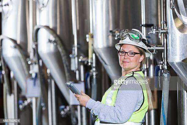 Woman working in manufacturing plant