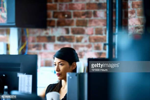 woman working in modern office - information equipment stock pictures, royalty-free photos & images