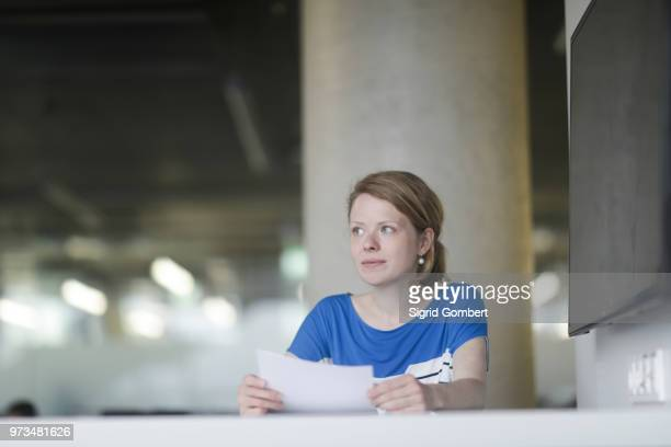 woman working in office - sigrid gombert stock pictures, royalty-free photos & images
