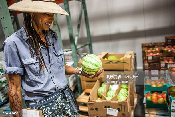 Woman working in produce warehouse