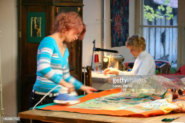 woman working in quilt workshop at katariina gild. - harjumaa stock pictures, royalty-free photos & images
