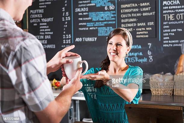 Woman working in restaurant helping customer