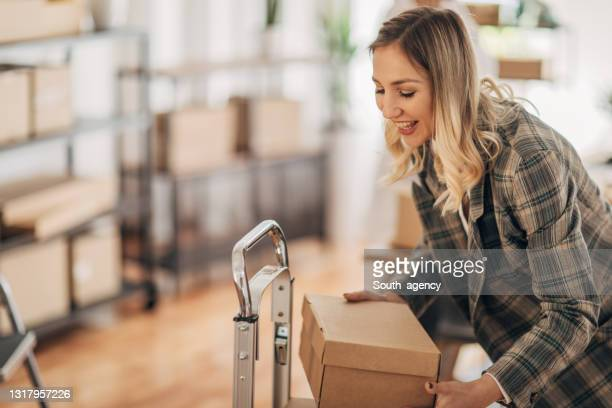 woman working in storage room for shipping - south_agency stock pictures, royalty-free photos & images