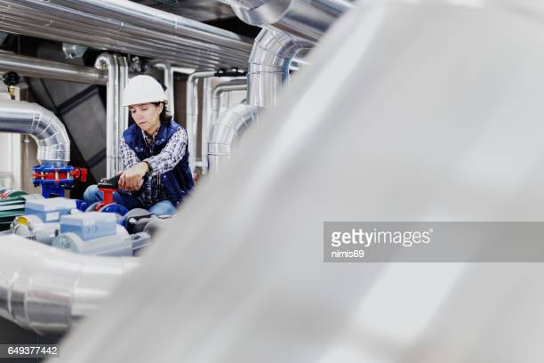 Woman working in the boiler room