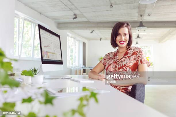 woman working in the eco friendly office - economist stock pictures, royalty-free photos & images