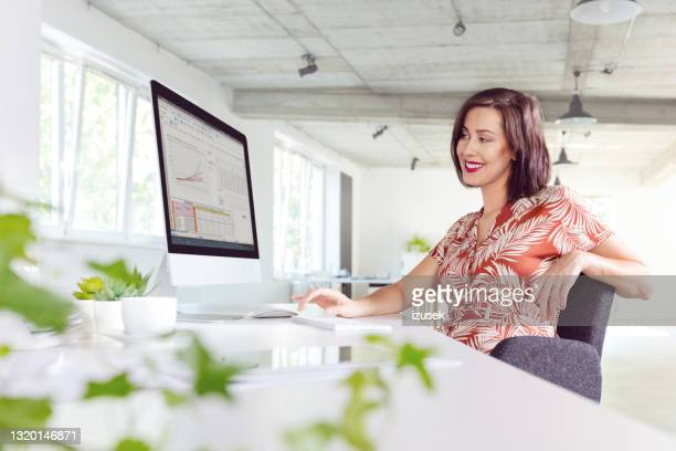 woman working in the office - economist stock pictures, royalty-free photos & images