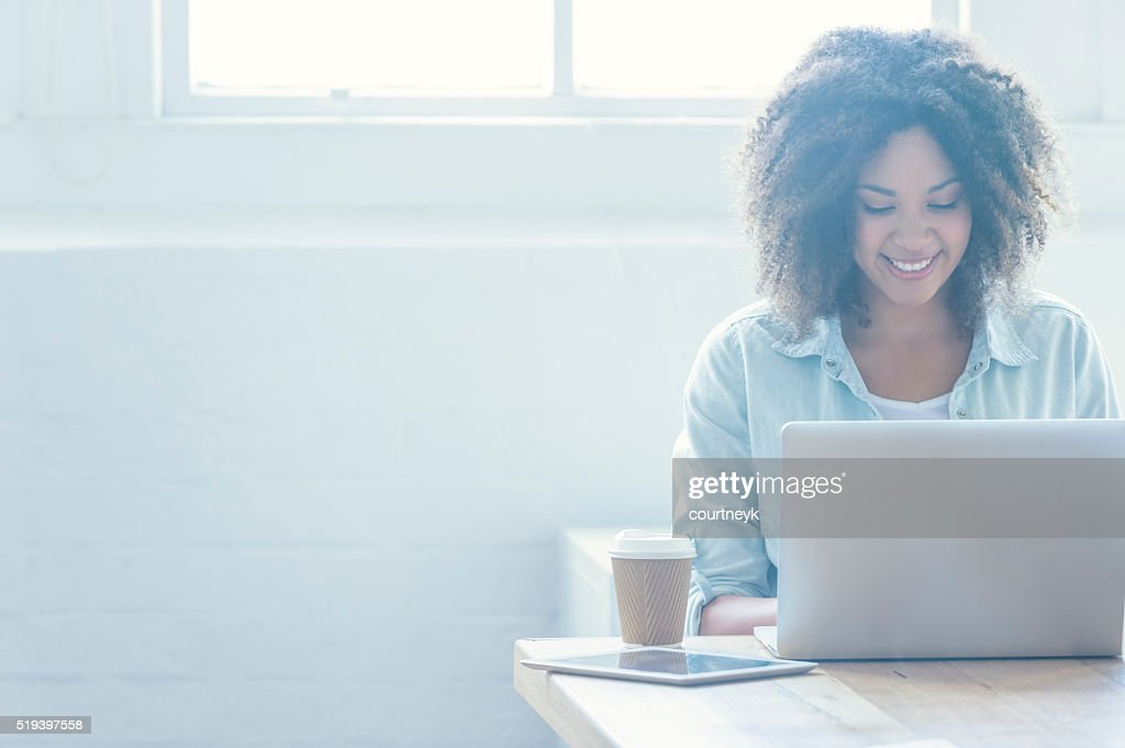 Woman working on a laptop. : Stock Photo