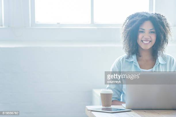 Woman working on a laptop.