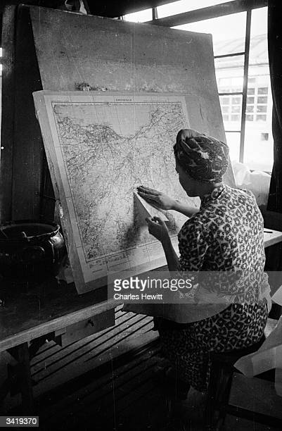 Woman working on a newly-printed map at the Scottish Survey office of cartography. When the Ordnance Survey introduced a new scale of mapping in 1947...