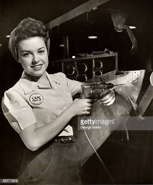 Woman working on aircraft assembly line