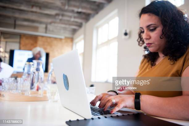 Woman working on laptop computer at the office