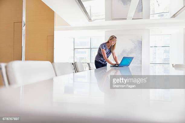 Woman working on laptop in meeting room
