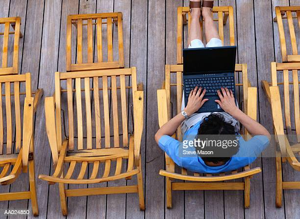 Woman Working on Laptop on Cruise Ship
