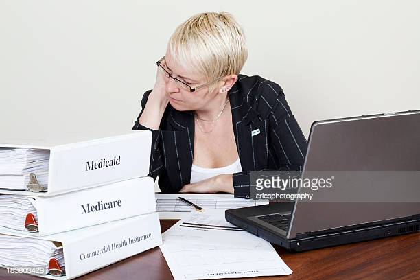 Woman working on medical claims