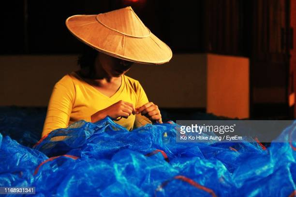 woman working on plastic bags - ko ko htike aung stock pictures, royalty-free photos & images