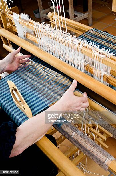 Woman Working On Some Patterned Material Being Woven on  Loom