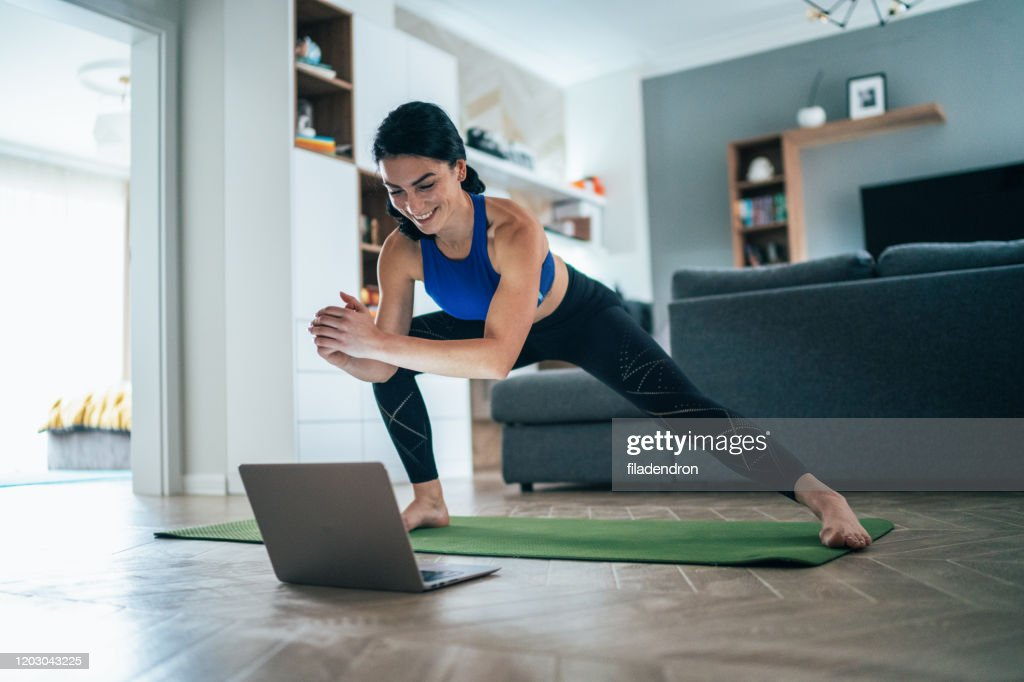 Woman working out at home : Stock Photo