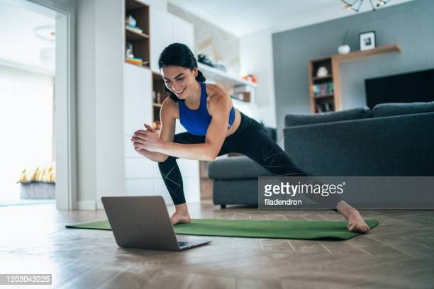 woman working out at home - exercising stock pictures, royalty-free photos & images