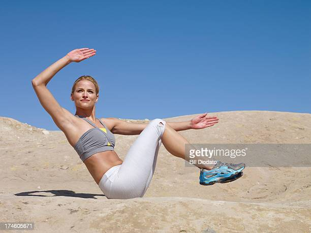 Woman working out on rocks