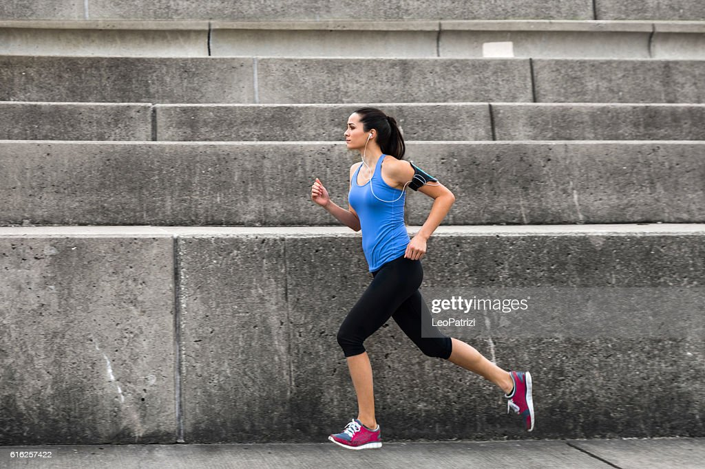 Woman working out outdoor in the city : Stock Photo