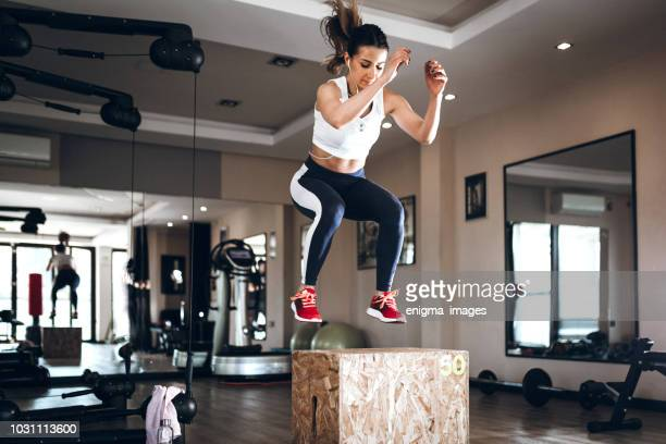 woman working out - sportswear stock pictures, royalty-free photos & images