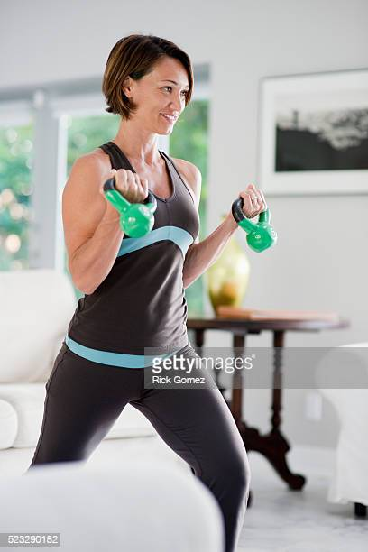 woman working out - mid adult stock pictures, royalty-free photos & images