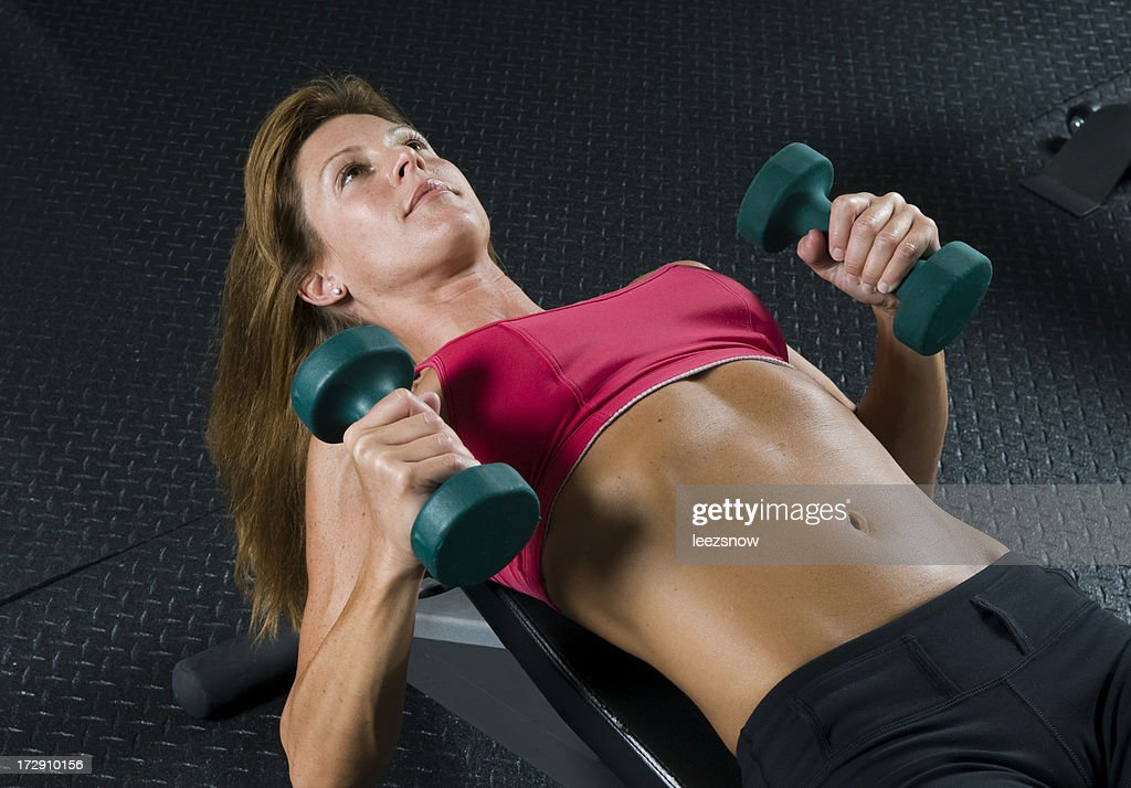 Woman Working Out With Dumbbells : Stock Photo
