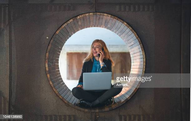 woman working outdoors - circle stock pictures, royalty-free photos & images