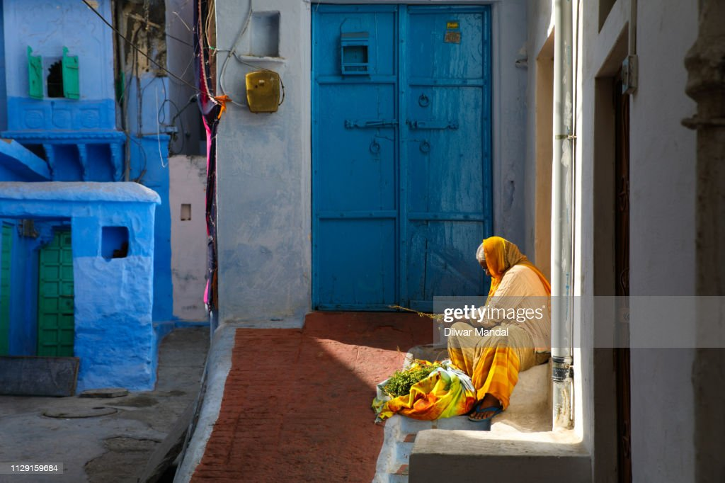 Woman working outside the residence : Stock Photo