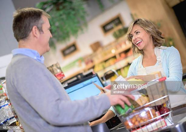 Woman working the cashier at a supermarket