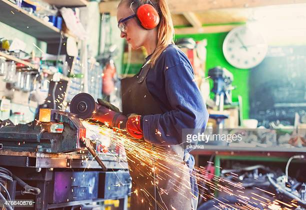 woman working with an angle grinder - leanincollection stock pictures, royalty-free photos & images