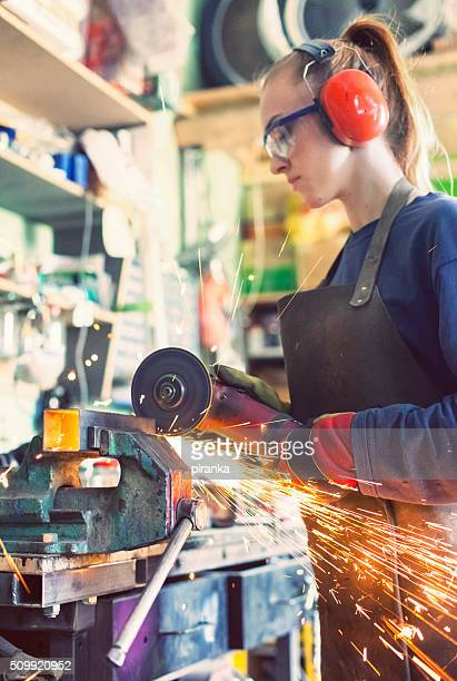 Woman working with an angle grinder