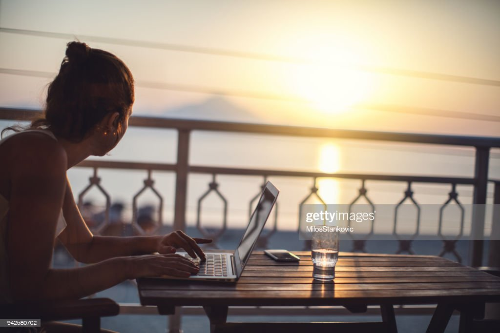 Woman working with laptop at summer vacation : Stock Photo