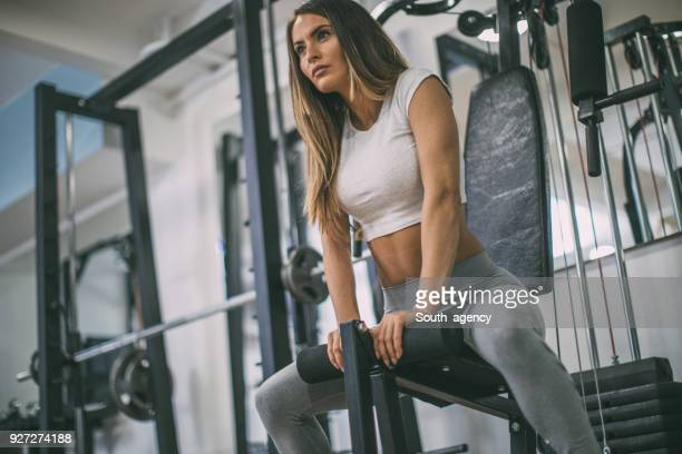 woman workout in the gym - beautiful woman chest stock pictures, royalty-free photos & images