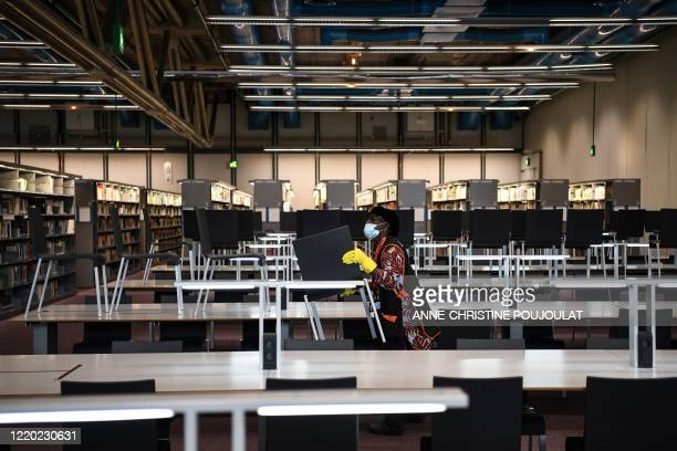 Woman works at a library of the Centre Georges Pompidou modern art museum, on June 15, 2020 in Paris, currently closed to the public and due to...