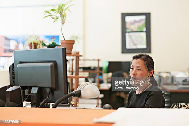 Woman works at computer