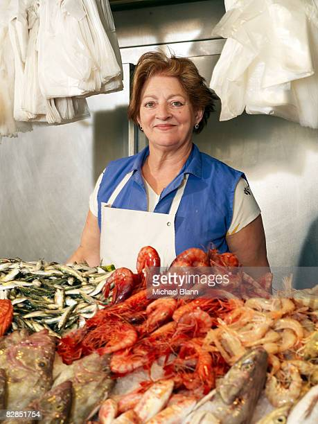 Woman works at fish stall