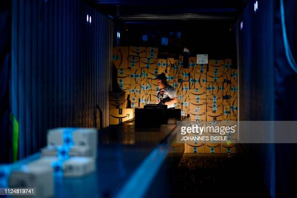 A woman works at in a delivery truck at the 855000squarefoot Amazon fulfillment center in Staten Island one of the five boroughs of New York City on...