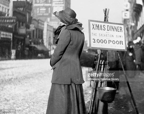 A woman works for the Salvation Army collecting money for Christmas dinners for the needy
