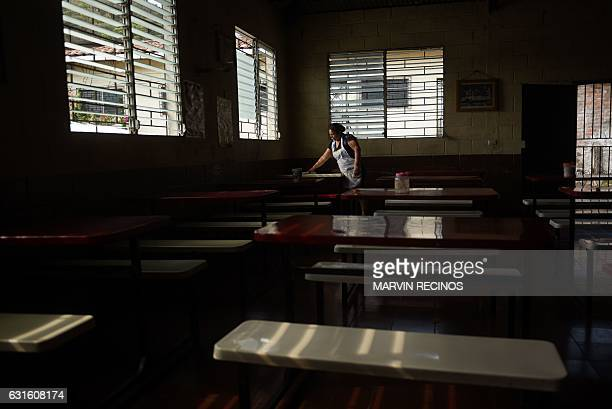 A woman works in a community cafeteria in San Jose Las Flores 100 km north of San Salvador on January 7 2017 A majority of the residents of San Jose...