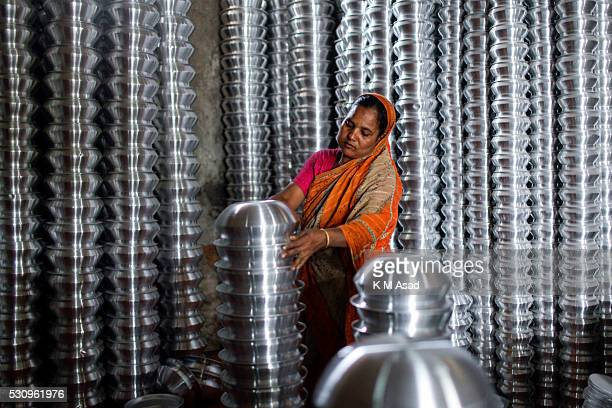 OLD DHAKA DHAKA BANGLADESH A woman works in an aluminum cookware factory in Dhaka Bangladesh May 08 2016 Many Bangladeshi lower class people live in...